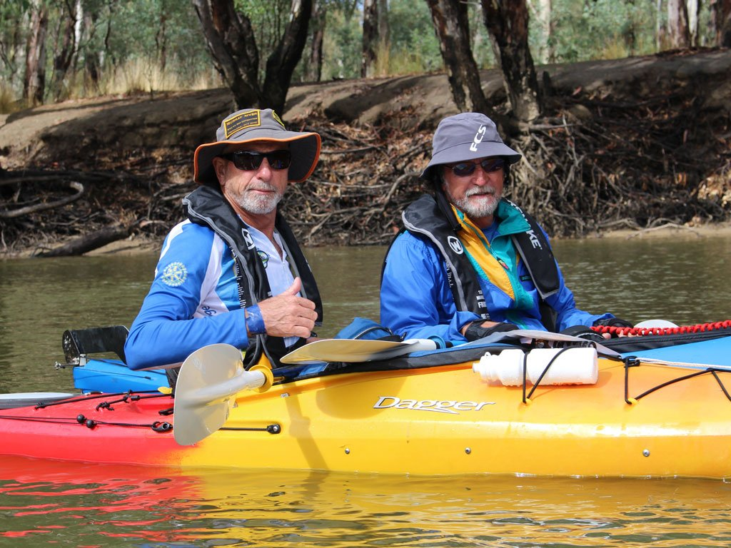 Two kayakers wearing level 100+ lifejackets