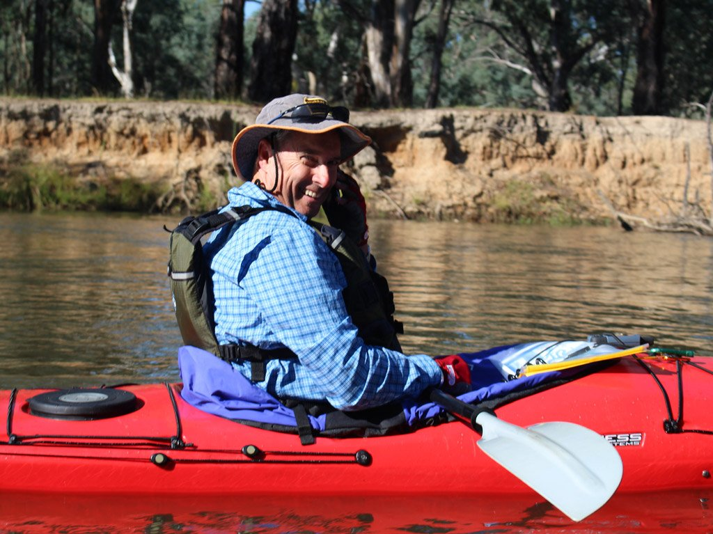 Picture of smiling kayaker using safety equipment