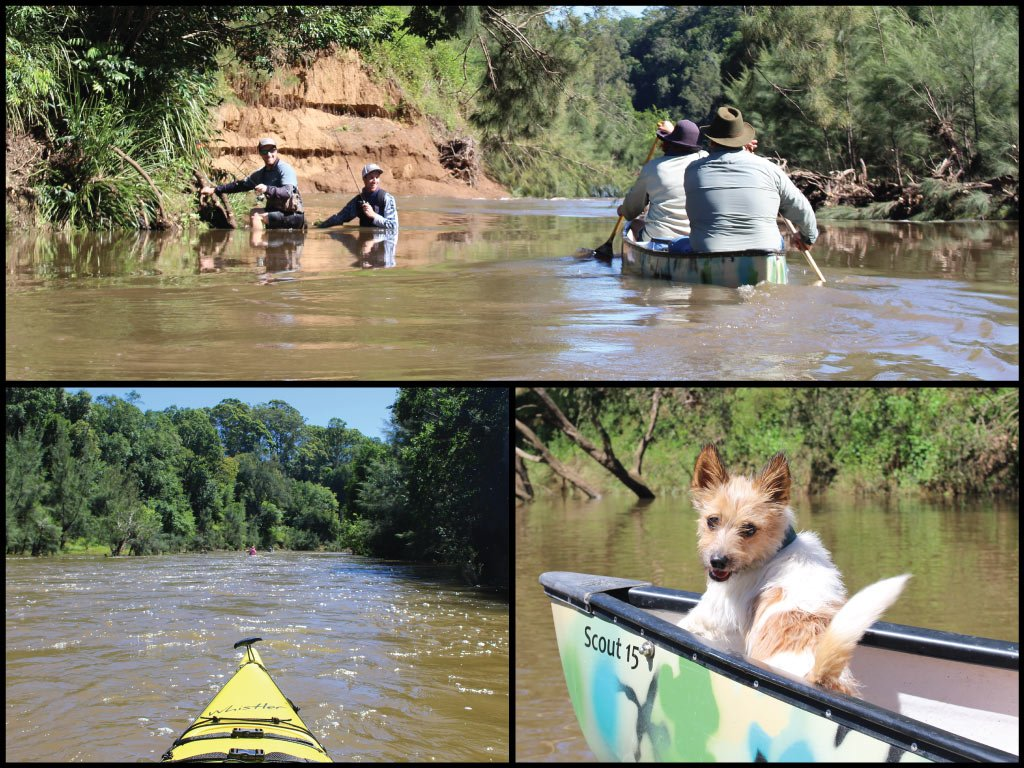 Canoeists, dog in a canoe, kayak, and fishermen at the Mary River in Kandanga