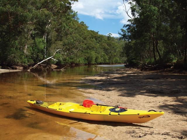 Kayak on sandy shore at Mooney Mooney Creek