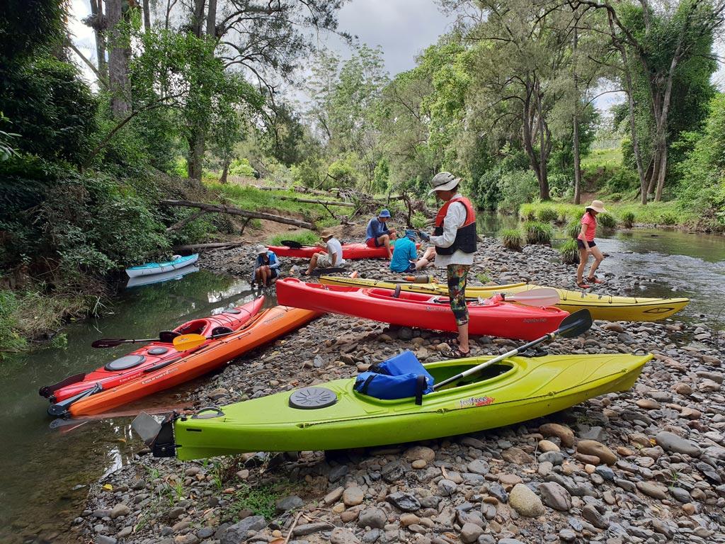 Kayaking friends taking a morning tea break at Iron Pot Creek in Toonumbar