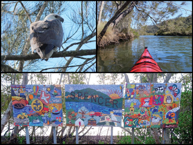 Kayak, white-bellied sea eagle, and mosaic Spencer sign at Spencer