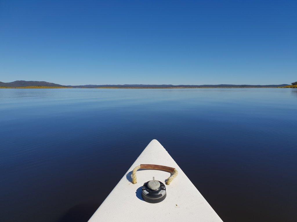 Canoe bow and glassy water at Lake Copeton